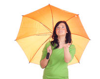 Young woman with orange umbrella Royalty Free Stock Photography