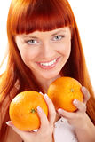 Young woman with oranges Royalty Free Stock Images