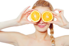 Young woman with oranges. In her hands isolated on white Stock Photos
