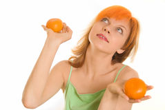 Young woman with oranges Stock Photos