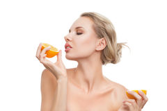 Young woman with oranges in her Stock Photos