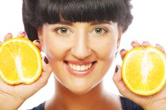 Young woman with oranges in her hands Royalty Free Stock Image