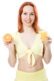 Young woman with oranges and juice. On a white background Royalty Free Stock Images