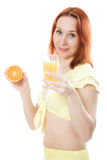 Young woman with oranges and juice. In her hands Stock Photo