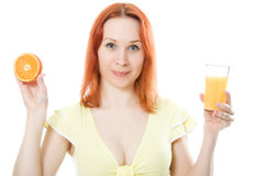 Young woman with oranges and juice. In her hands Stock Image