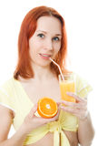Young woman with oranges and juice. On a white background Royalty Free Stock Photo