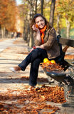 Young woman with oranges in park at fall Royalty Free Stock Photos