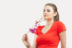 Young woman with orchid Stock Photo