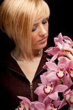 Young woman with orchid Royalty Free Stock Images