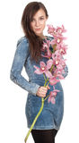 Young woman with orchid Stock Image