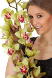 Young woman with orchid Royalty Free Stock Photo