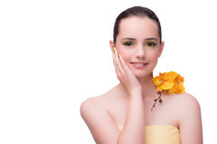 The young woman with orchid flower isolated on white. Young woman with orchid flower isolated on white Stock Photography