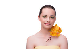 The young woman with orchid flower isolated on white. Young woman with orchid flower isolated on white Royalty Free Stock Photo