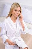 Young woman ordering from catalogue Stock Photos