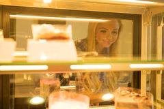Young woman ordering in a coffee shop. A beautiful young woman ordering from a nice girl at the bar in a coffee shopr Stock Photography