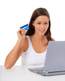 Young woman ordering via internet Royalty Free Stock Images