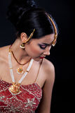 Young woman with oriental makeup and Indian Jewelry. Beautiful girl with oriental makeup and Indian Jewelry, fashion look Royalty Free Stock Image