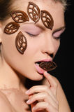 Young woman with ornaments made of chocolate Stock Photography