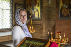 Young woman within the Orthodox Church. Tradition. Stock Photos