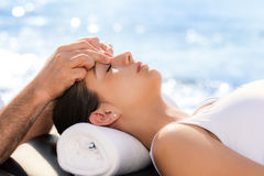 Young woman at osteopathic treatment session outdoors. Stock Photo