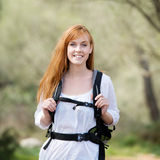 Young woman out hiking with a rucksack Royalty Free Stock Images