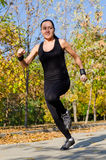 Young woman out jogging Stock Image