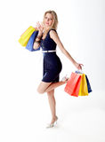 Young woman out for shopping. A young beautiful blond woman out for shopping Royalty Free Stock Photos