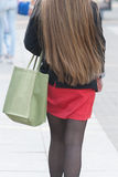 Young woman out shopping. Focus on shopping bag. Stock Photos