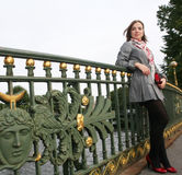 Young  woman outdoor on the bridge Stock Photo