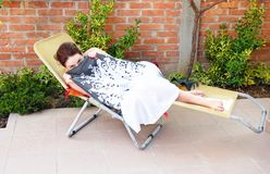 Young woman in outdoor chair Royalty Free Stock Photos