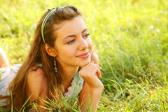 Young woman outdoor in the grass in summertime Stock Image