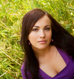 Young woman outdoor in the grass in summertime. Pretty young woman outdoor in the grass in summertime Stock Images