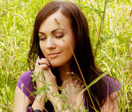 young woman outdoor in the grass in summertime Royalty Free Stock Images