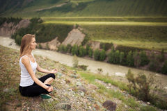 Young Woman Outdoor Meditation. Sitting on the Mountain. Royalty Free Stock Photos