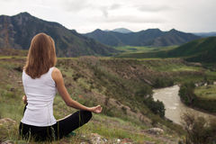 Young Woman Outdoor Meditation. Sitting on the Mountain. Royalty Free Stock Photography