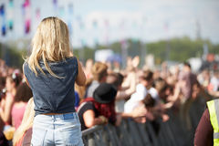 Young Woman At Outdoor Music Festival. Having Fun royalty free stock image