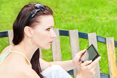 Young woman outdoor with tablet PC Royalty Free Stock Image