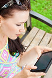 Young woman outdoor with tablet PC Stock Images