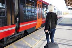 Young woman at a outdoor train terminal Royalty Free Stock Photos