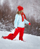 Young woman outdoor in winter. Young woman with slay,l looking in the distance, in winter Royalty Free Stock Photo