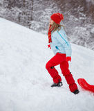 Young woman outdoor in winter. Young woman with slay, climbing the slope, in winter Royalty Free Stock Photography