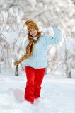 Young woman outdoor in winter. Enjoying the snow Stock Photo