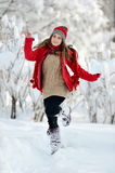 Young woman outdoor in winter enjoying the snow Stock Photo