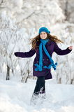 Young woman outdoor in winter enjoying the snow Royalty Free Stock Images