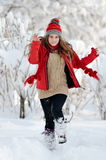Young woman outdoor in winter enjoying the snow Stock Image