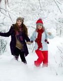 Young woman outdoor in winter enjoying the snow Royalty Free Stock Image