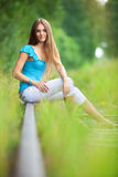 Young woman outdoors stock images