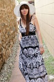 Young woman outdoors. Woman in dress and hat outside on a summer day Royalty Free Stock Images