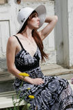 Young woman outdoors. Woman in dress and hat outside on a summer day Stock Photos