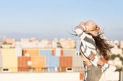Young woman outdoors on city background in sunny day Stock Photography